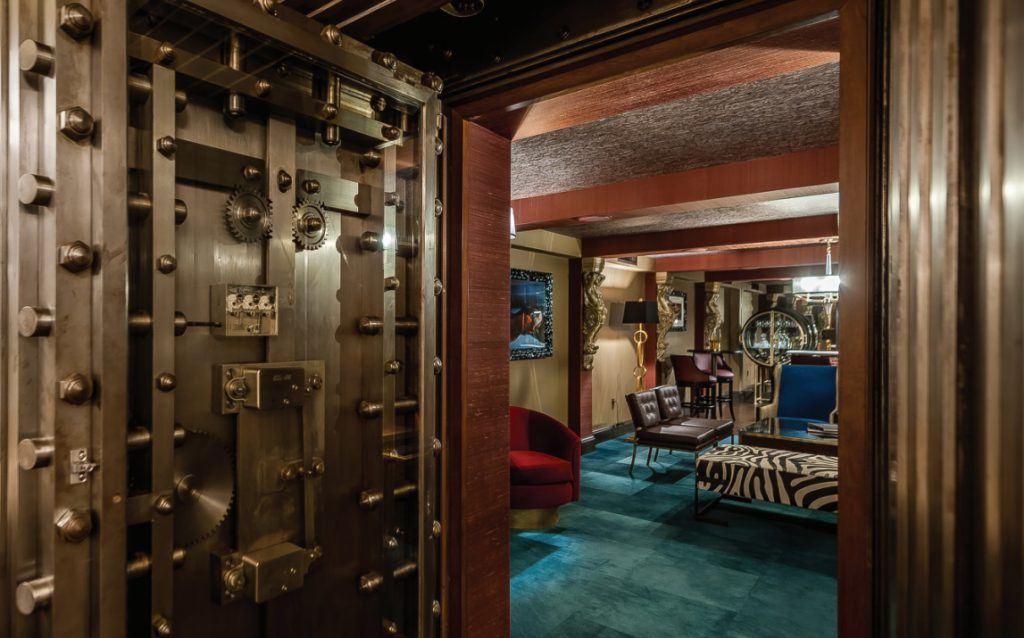 Original vault door, restored, opens to a private dining space