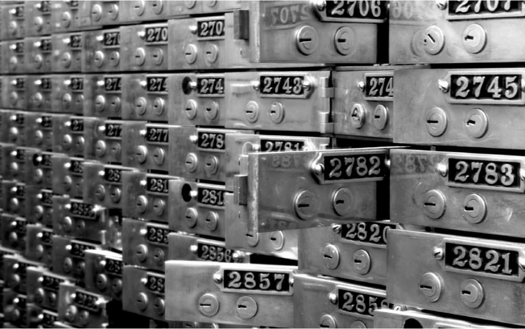 Original safe deposit boxes in front of the bar